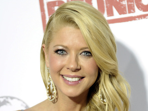 "Actress Tara Reid from the cast of the movie ""American Reunion"" poses for photos before the Australian premiere in Melbourne"