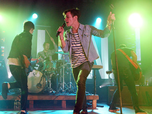 Nate Ruess, center, performs with his band fun