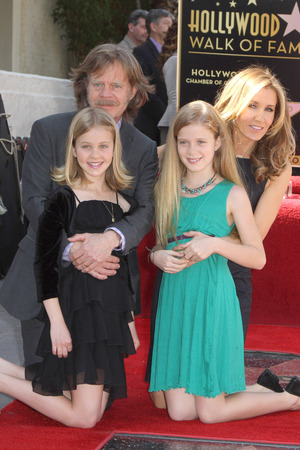 Felicity Huffman and her husband William H. Macy and their daughters