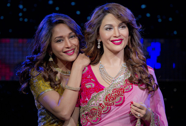 Bollywood actress Madhuri Dixit-Nene, left, stands alongside her brand new wax figure at Madame Tussauds, London