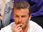 David Beckham dad sues News International