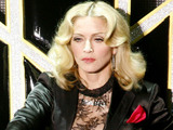 Madonna performs at the Olympia theater to promote her latest album &quot;Hard Candy&quot;, in Paris