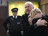 Phil comforts Shirley as the police begin their questioning.
