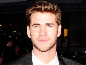 Liam Hemsworth arrives at the premiere of The Hunger Games at the O2 in London.