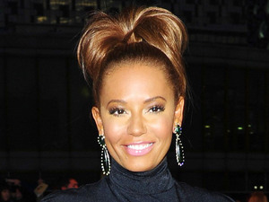 Mel B arrives at the premiere of The Hunger Games at the O2 in London.