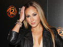 Adrienne Bailon admits that she will get another boob job if she breastfeeds.