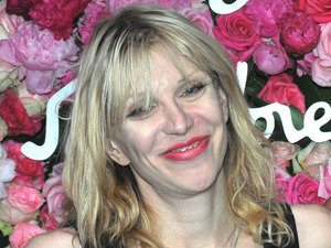 Courtney Love warns LeAnn Rimes's detractors that they will have to deal with her.