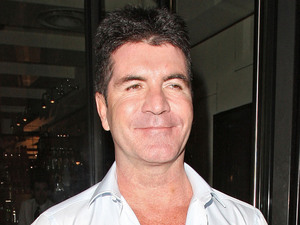 Simon Cowell leaving C London restaurant after dining together with friends.