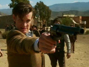 The Doctor pulls a gun in the Dcotor Who season 7 first look trailer