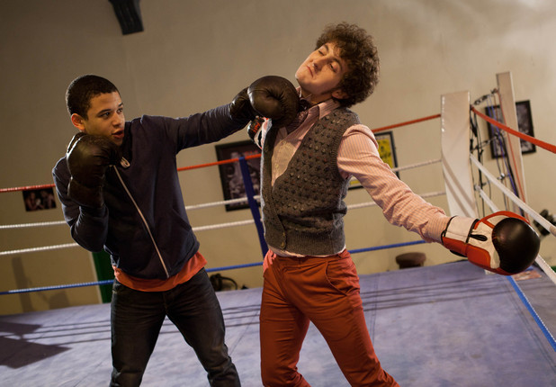 Scott shows Barney some tricks in the boxing ring.