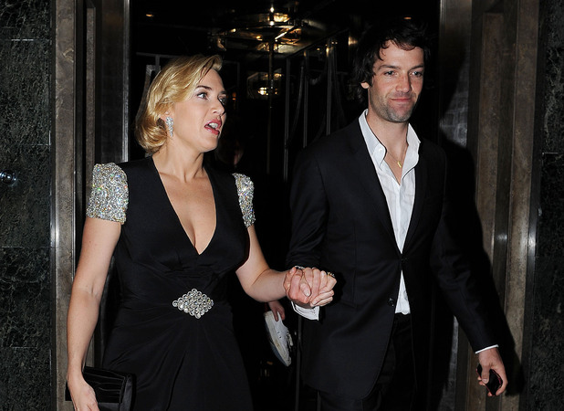 Kate Winslet with with boyfriend Ned Rocknroll, leaves Claridge's Hotel wearing a glistening Jenny Packham black gown London,