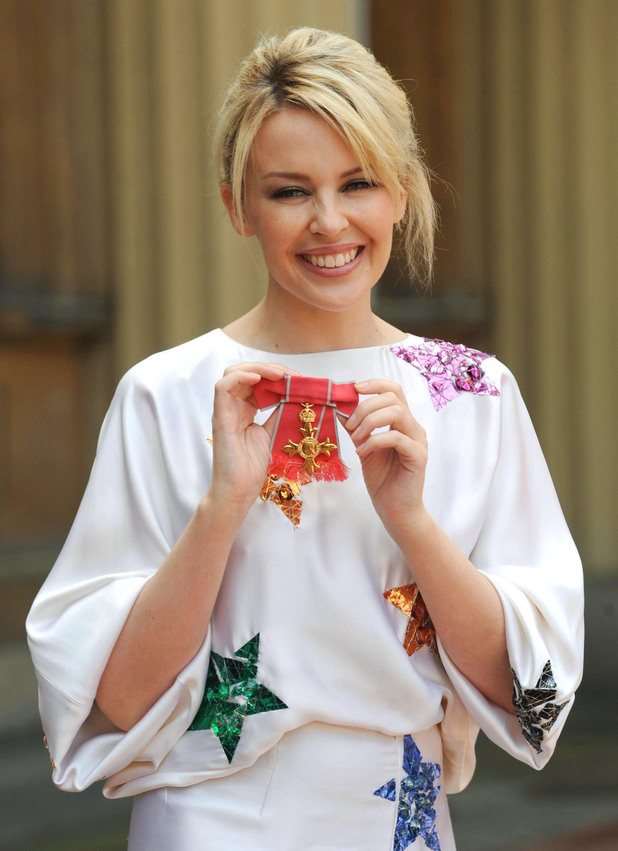 Kylie Minogue with her OBE