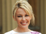 Kylie Minogue with her OBE for services to music