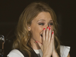 Kylie Minogue reacts to the applause of the crowd as she performs at the Manchester Academy as part of 'Anti-Tour'