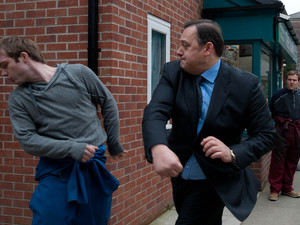 Tyrone rushes over to break the fight up as Tommy brawls with the other man