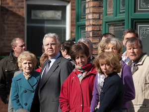 Silence descends upon Coronation Street as Betty's funeral cortege departs and the residents look on
