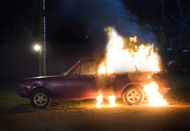 Michael's beloved car burns after Natasha sets fire to it.