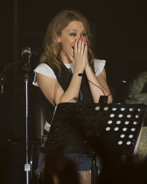 Kylie Minogue reacts to the applause of the crowd