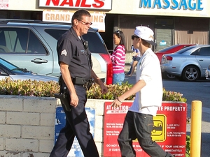 Justin Bieber is asked by a Los Angeles police officer to move his 60k Fisker Karma electric car with customized chrome paint work which was illegally parked outside shops