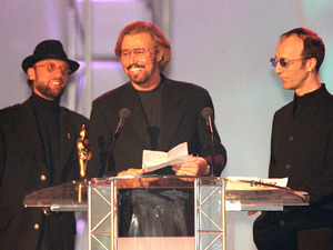 Robin, Barry and Maurice Gibb, accept the Brit Award for Outstanding Contribution in 1997