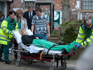 Audrey is rushed to hospital by the paramedics