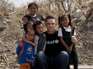 Soccer Aid England captain Robbie Williams meets children living in slums in Mexico City