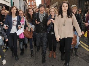 X Factor finalist Louis Tomlinson from boy band One Direction is mobbed by fans as he goes shopping in Covent Garden. London