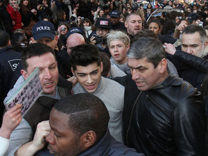 Zayn Mailik and Niall Horan, of boy band One Direction mobbed by hundreds of hysterical fans as they arrive by Eurostar at Gare Du Nord. The are in the french capital only for a few hours to appear on TV show Le Grand Journal on Channel Canal+. Paris, France - 20.02.12