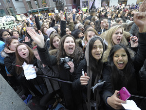 One Direction fans queue ahead of the band's performance at  NEW.MUSIC.LIVE Toronto, Canada