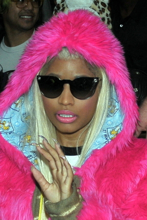 Nicki Minaj is greeted by hundreds of fans at Heathrow airport.