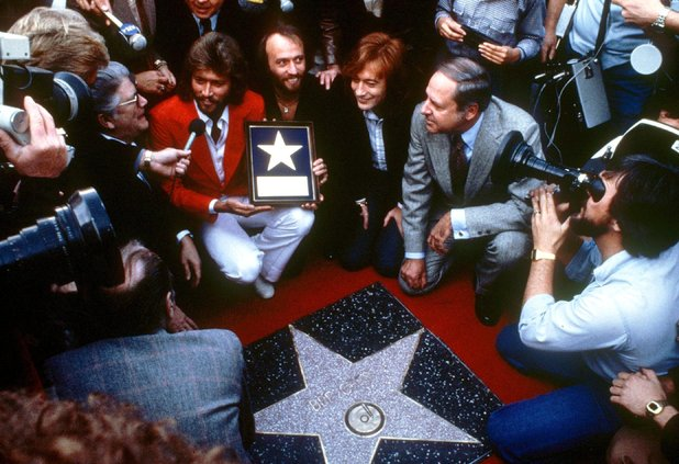 The Bee Gees are given a star on the Hollywood Walk of Fame in 1979