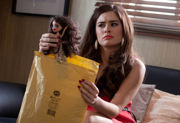 Mitzee receives a creepy barbie doll dressed as her.