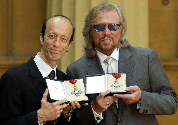 Robin and Barry Gibb hold their CBE's