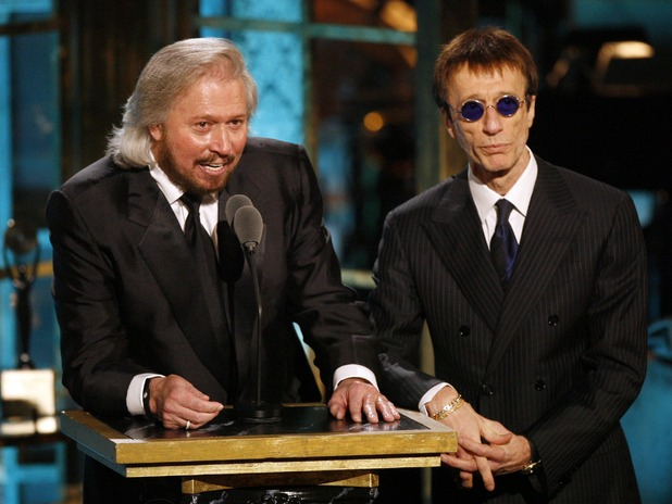 Barry and Robin Gibb appear on stage during the Rock and Roll Hall of Fame induction ceremony in New York