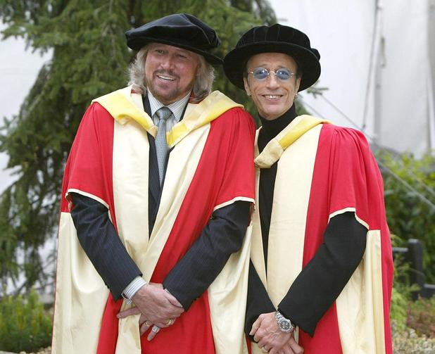 Barry and Robin Gibb pose for photographers