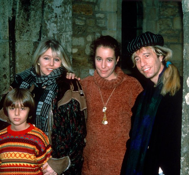 Robin Gibb with his wife and family