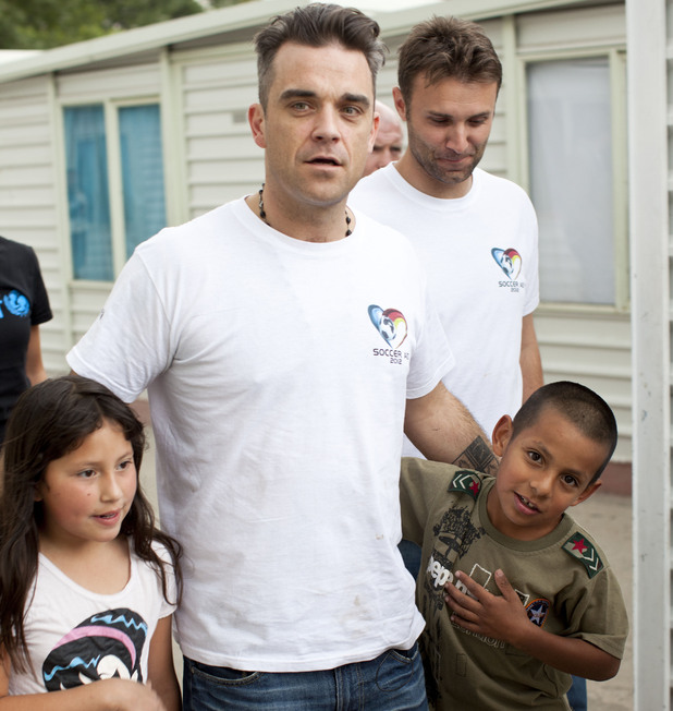 Soccer Aid England captain Robbie Williams and Jonathan Wilkes meet children at a shelter in Mexico City