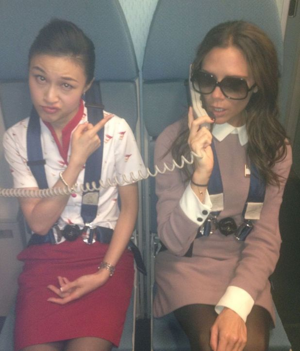 Victoria Beckham joins cabin crew on Beijing flight