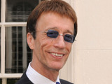 Robin Gibb, founding member of the Bee Gees, unveils a plaque honouring the work of the Bee Gees at 67 Brook Street, central London
