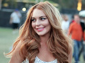 Lindsay Lohan is alleged to have thrown a drink at a female clubgoer in LA.
