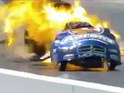 Driver Matt Hagan is left unscathed after his car is engulfed in a fireball.