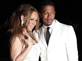 Mariah Carey Nick Cannon pose after renewing their vows.