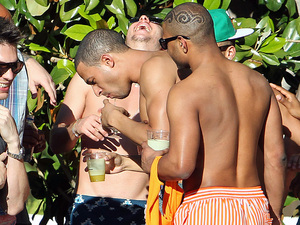 Marvin Humes is egged on by bandmate JB, real name Jonathan Gill, of JLS as he drinks shots by the pool at the Encore, in Las Vegas, Nevada, on the first leg of his bachelor party Las Vegas