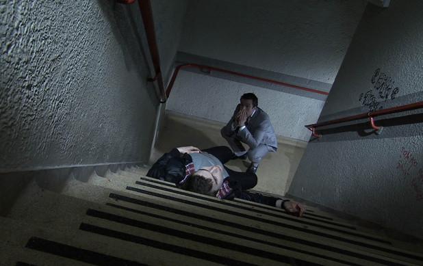 Brendan looks on at Joel's lifeless body.