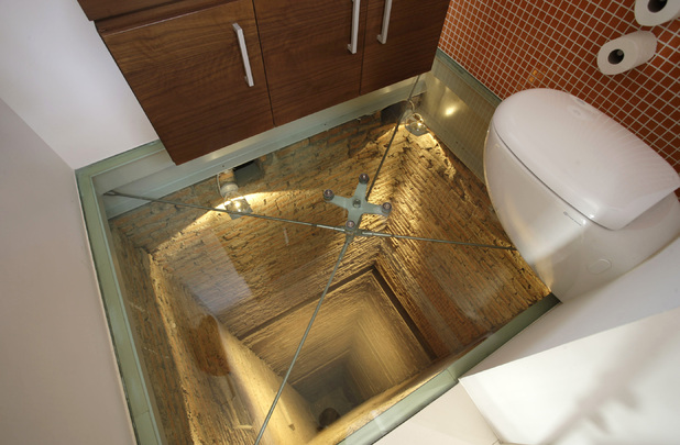 Toilet suspended above a 15-storey lift shaft