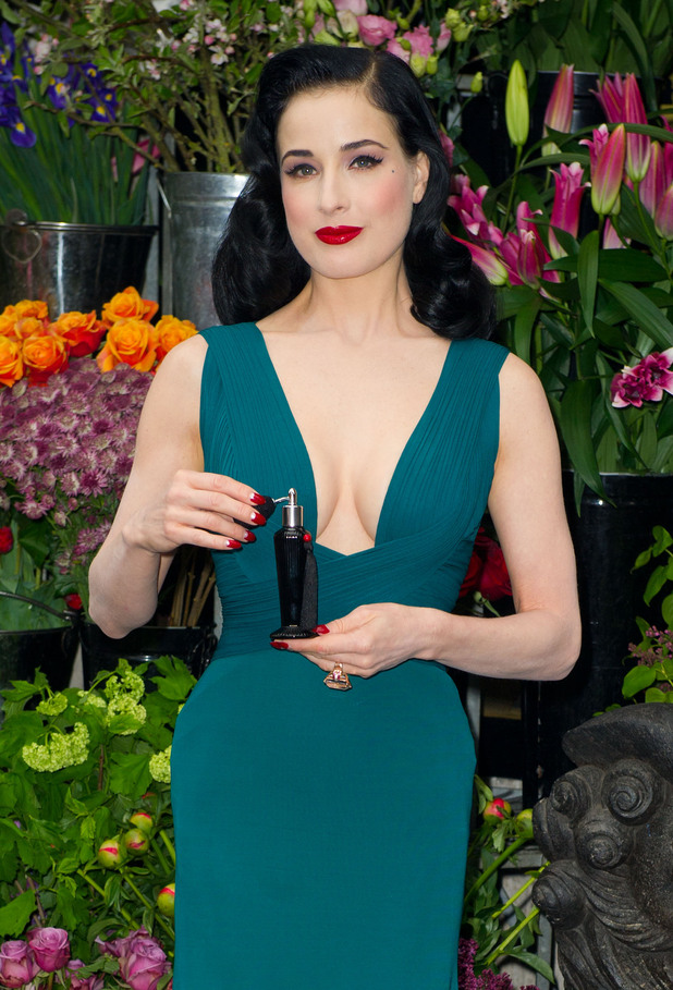 Dita Von Teese in front of a flower stand during her perfume launch at Liberty, London - May 1, 2012