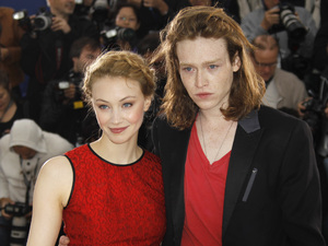Sarah Gadon and Caleb Landry Jones pose during a photo call for Antiviral.