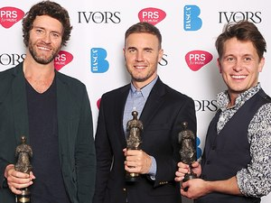 Howard Donald, Gary Barlow, and Mark Owen from Take That with the PRS For Music Outstanding Contribution to British Music award at the 2012 Ivor Novello awards held at the Grosvenor House Hotel, London