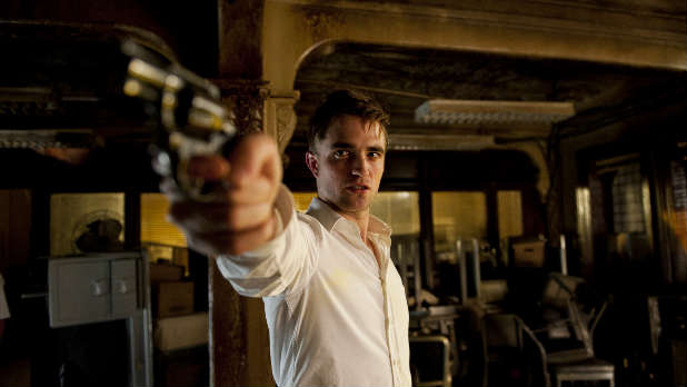 'Twilight' star Robert Pattinson heads across New York in his limo in David Cronenberg's 'Cosmopolis'.