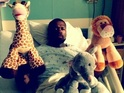 50 Cent appears with cuddly toys in his hospital bed after suffering a bug.